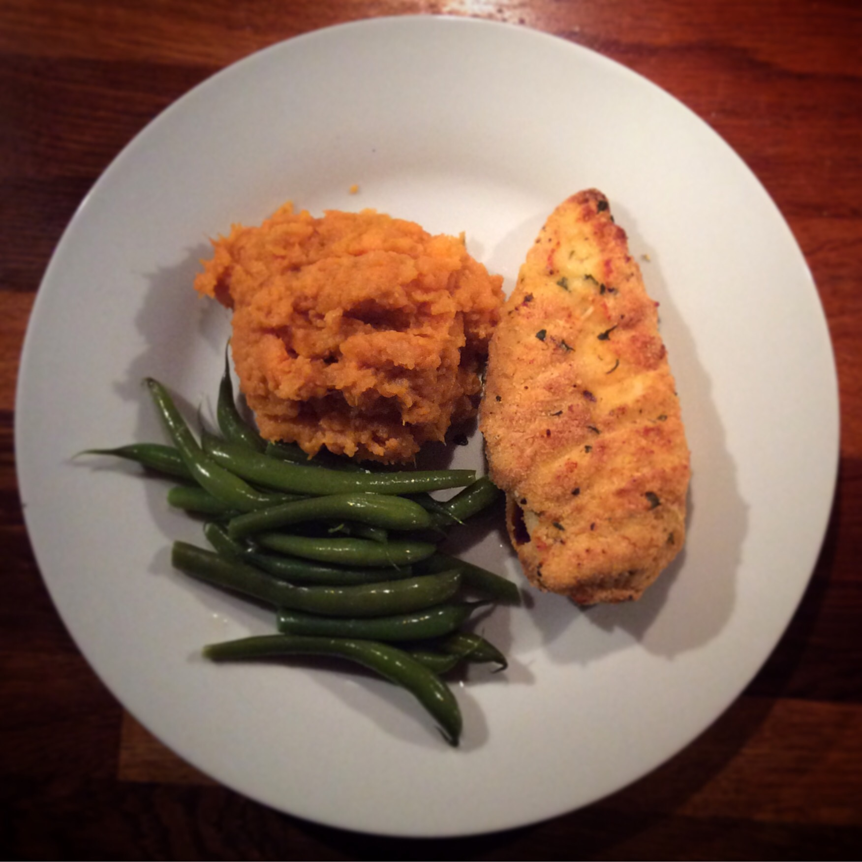 Polenta coated chicken  with  mashed sweet potato and green beans